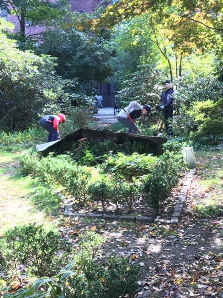 Volunteers plant in the Formal Garden