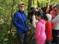 Neil Gore conducts a birding tour of Hall's Pond