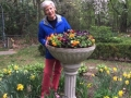 Marie Claire Kamin, just after she finished planing the urn with spring flowers.