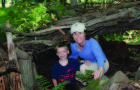 Priscilla Geigis and her nephew Grant pictured in front of their tree fort.