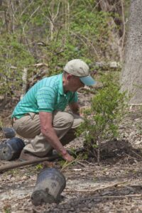 Frank helping restore Atlantic white cedars to Hall's Pond for the first time in generations, at the Spring 2009 Community Day.